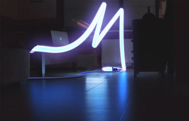 3D composition of a CG neon letter in real footage